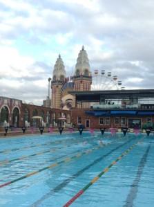 Luna Park smiles as pool patrons swim
